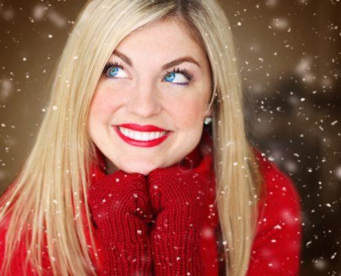 blonde, blue eyed woman smiling